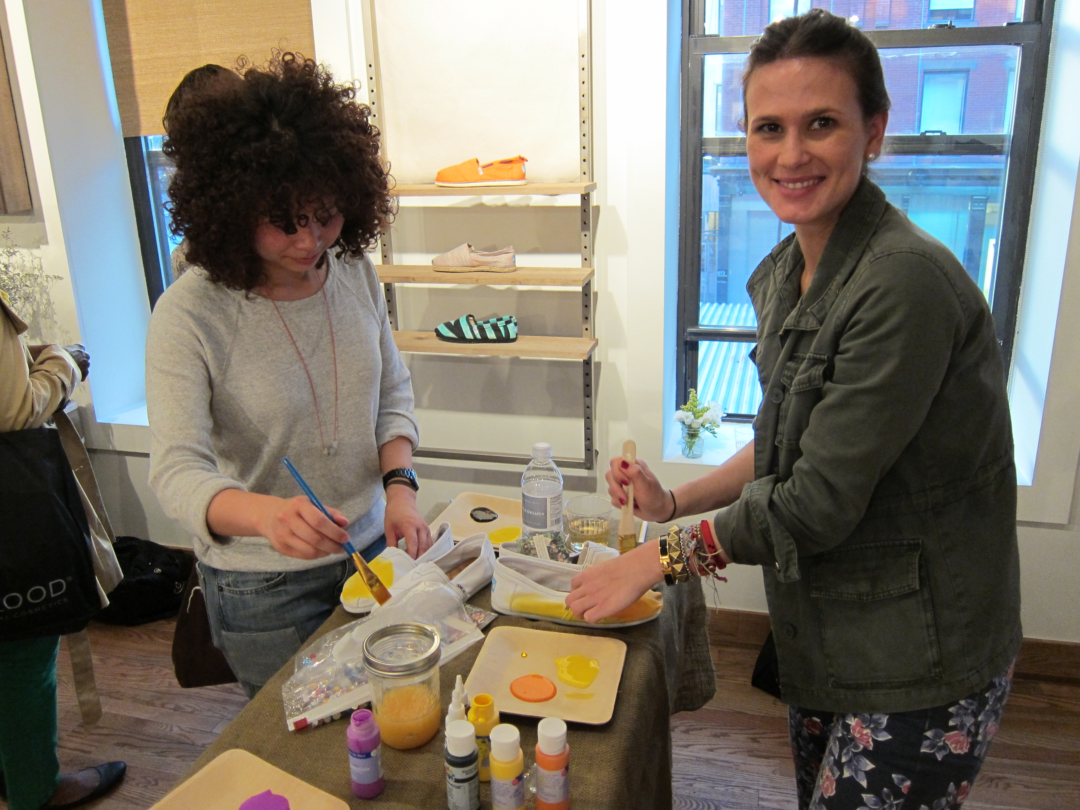 Associate editor Chi Chau and assistant editor Hannah Weil jumped right into painting their TOMS. Chi opted for a yellow base, and Hannah tried out an ombre effect, pairing orange, yellow, and a splash of pink.