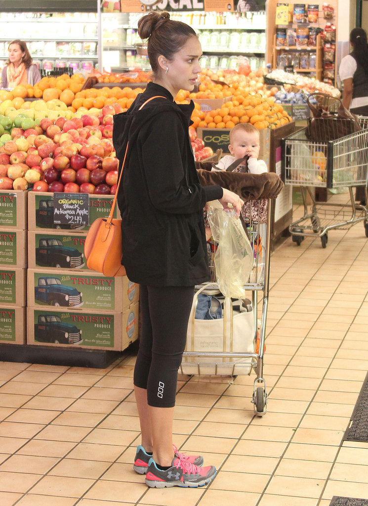 Jessica Alba debated what fruits and vegetables to buy as Haven Warren chewed on a strap from her seat in the grocery cart.