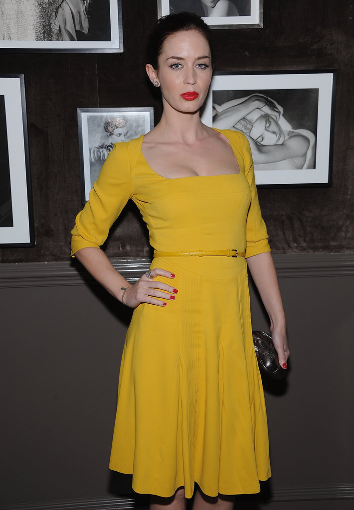 Emily Blunt wore a belted yellow dress to the Elie Saab private dinner in NYC.