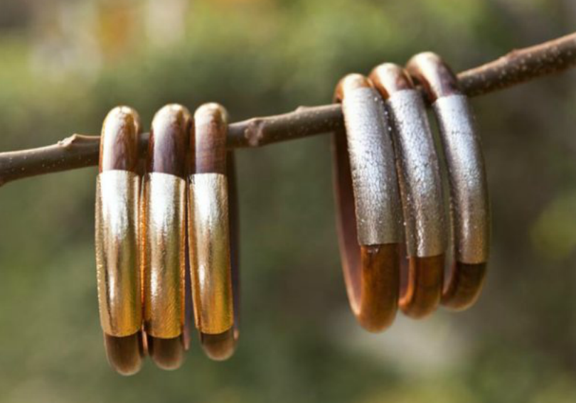 You can snag these wooden-meets-leather bangles in both silver and gold.
