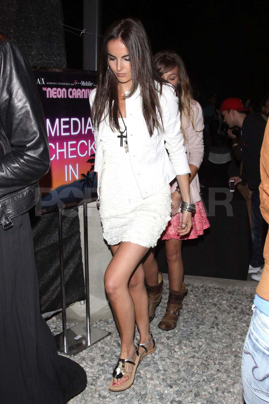 Camilla Belle arrived at the Neon Carnival party on Saturday night.