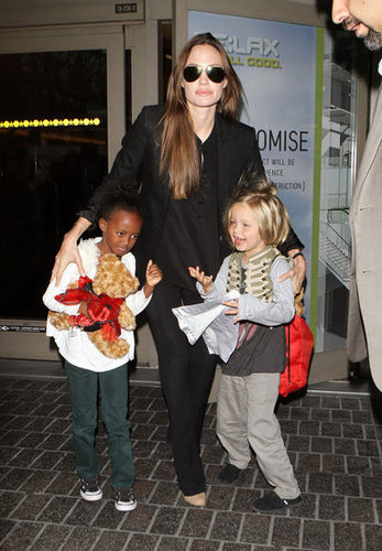 Angelina Jolie walked Zahara and Shiloh through LAX in December 2009.