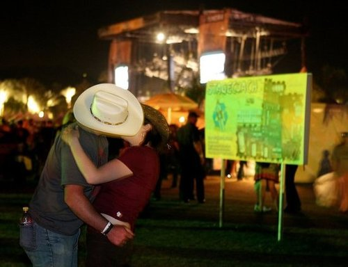 A cowboy kissed his girl at the Stagecoach Music Festival in Indio, CA.