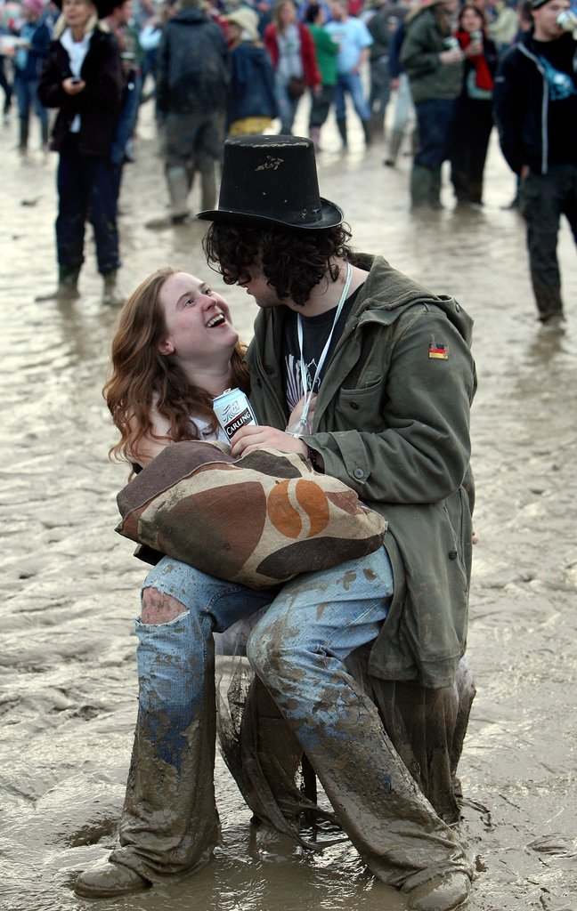 Glastonbury festivalgoers goofed off in the mud.