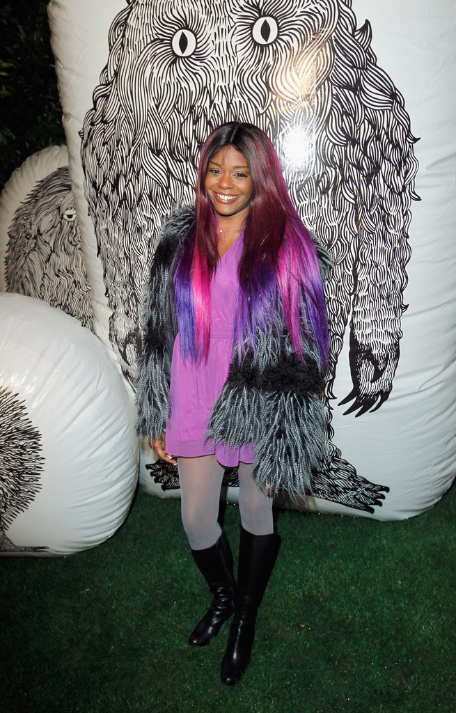 Rapper Azealia Banks opted for bold hues at the Mulberry fire pit party — plus, her fur topper really added an extra element of luxury.