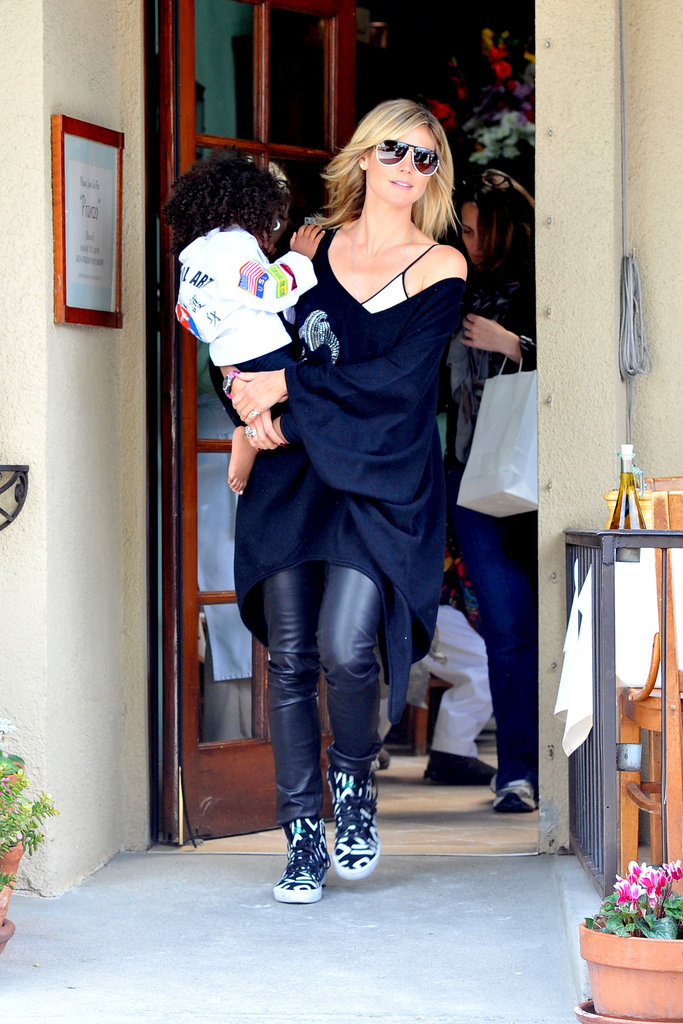 This time Heidi Klum rocked a pair of funky printed sneakers with leather pants.