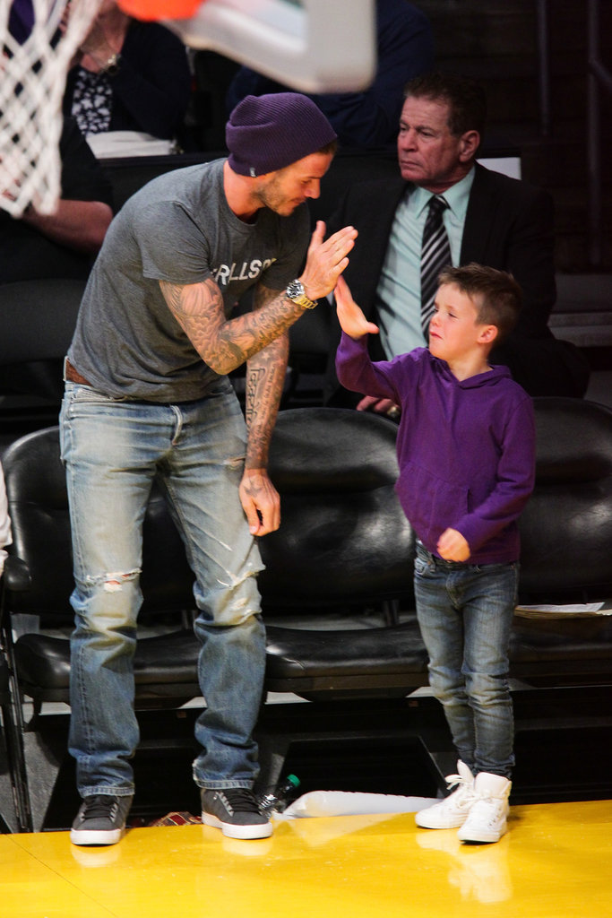 David Beckham gave son Cruz Beckham a high five at the Lakers game in LA.