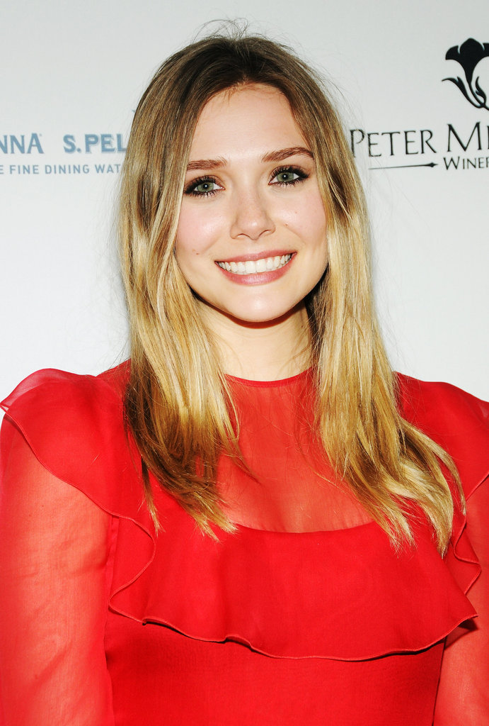 Elizabeth Olsen gave a smile at the Grand Chefs Dinner in NYC.
