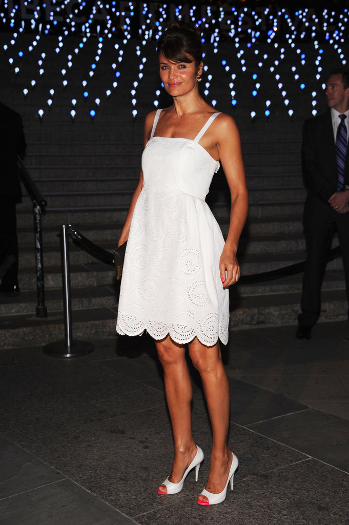 Helena Christensen wore a feminine white Marc Jacobs dress with pink cap-toe heels to the Vanity Fair bash for the 2012 Tribeca Film Festival.