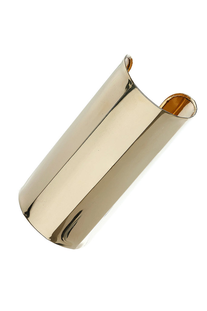 A powerful piece, the adjustable cuff covers over half of the forearm for dramatic flair.  Topshop Long Cuff ($35)