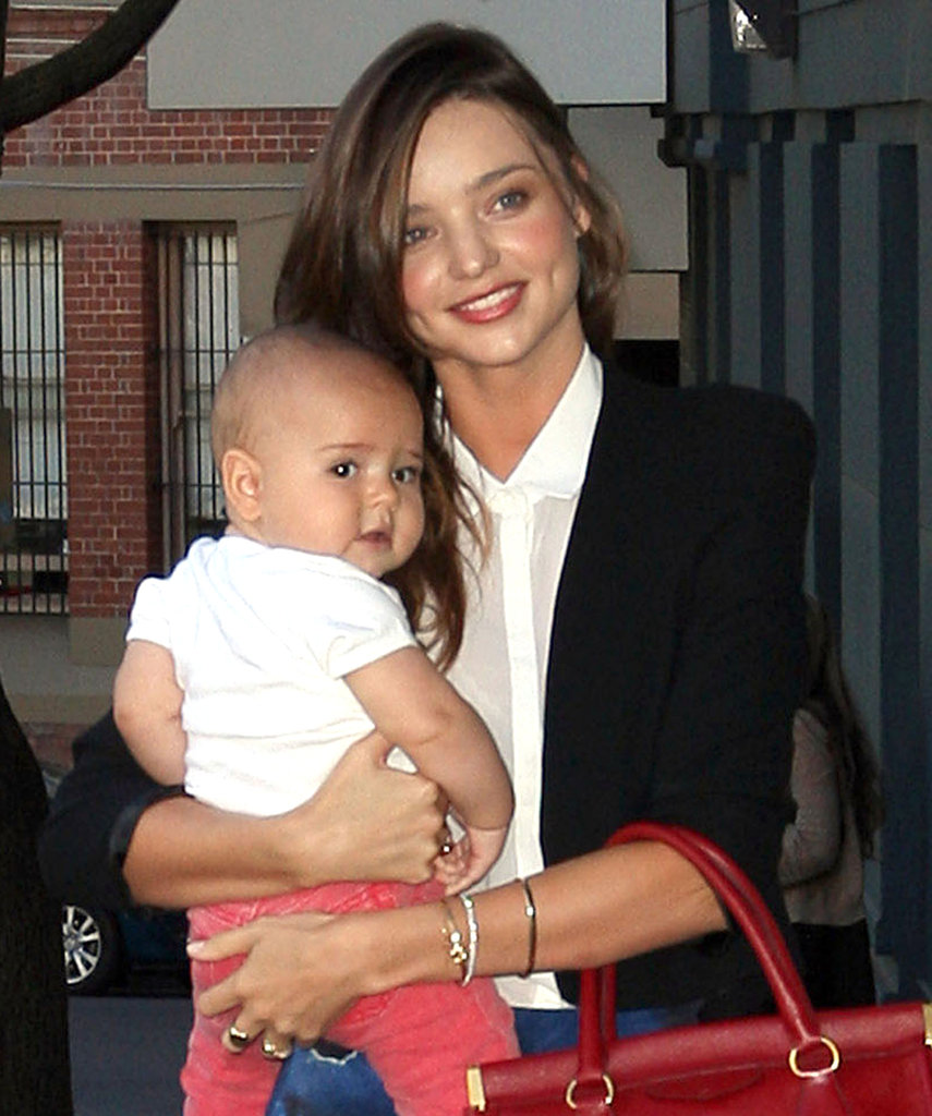 While visiting Sydney, Miranda Kerr carried Flynn Bloom and her large red purse in August 2011.