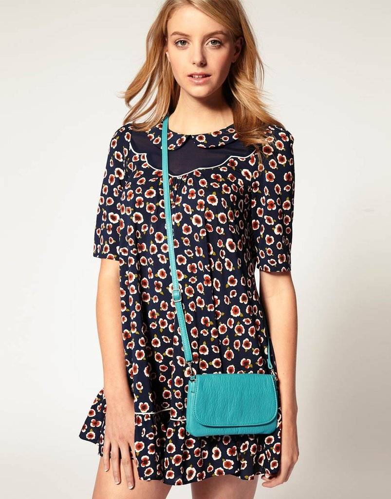 Sweet and simple, the statement turquoise bag complements offbeat printed dresses or bright white pieces as well. Pieces Noleta Cross Body Bag ($29)