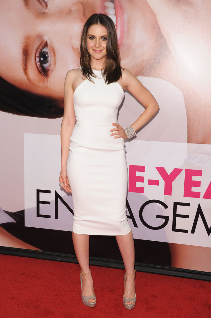 Community actress Alison Brie, who also scored a supporting role in The Five-Year Engagement, stepped out in a formfitting LWD and nude-toned ankle-strap sandals.