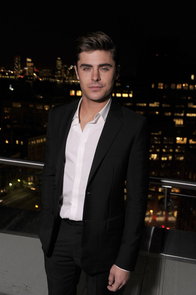 Zac Efron smiled at the Cinema Society and Men's Health screening of The Lucky One in NYC.