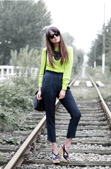 We love the crisp combo of high-waisted trousers and a classic tee done up in a statement-making hue.  Photo courtesy of Lookbook.nu
