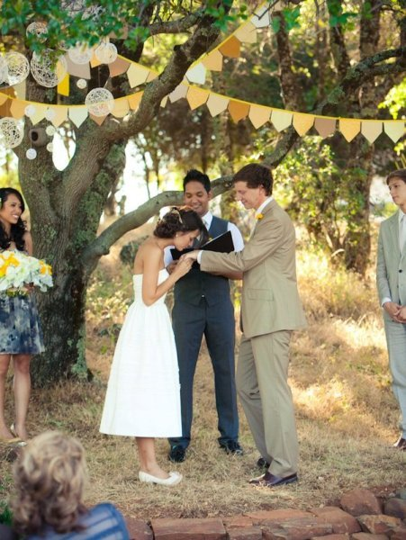 Dainty and charming, a simple garland in bright colors lends a sweet dose of character to the setting. Photo by Lexigraphics Photography via Style Me Pretty