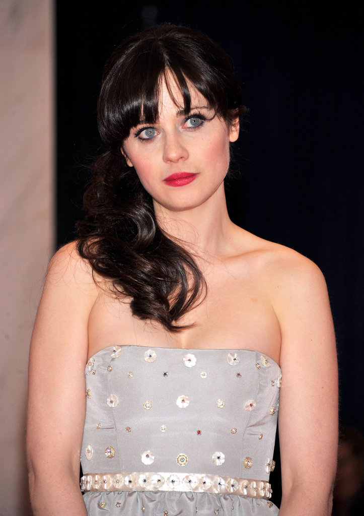 Zooey Deschanel wore a bright red lip with her silver gown.