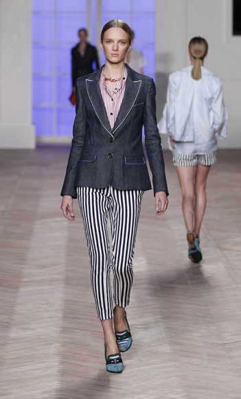 """""""After months of patiently waiting, these navy and striped pants are finally available for purchase. I'd pair these flattering skinnies with a loose tee, light blazer, and ankle-wrap sandals for a Kate Moss-inspired look."""" — Chi Diem Chau, associate editor  Tommy Hilfiger Moto Striped Pants ($398)"""
