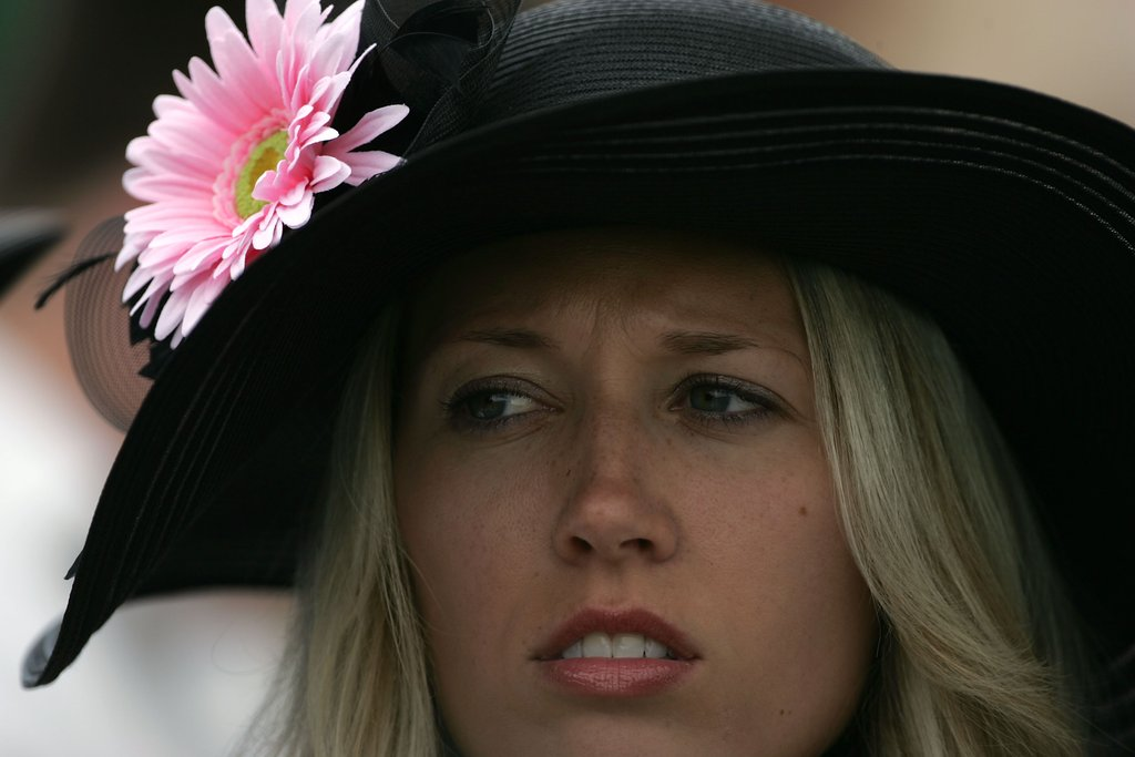 This pink flower gave a pop of color to the black hat in 2011.