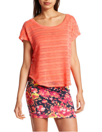 In a bright coral shade, this sheer hacci-knit tee pairs well with both bold prints and worn-in denim.  Charlotte Russe Hi-Low Hacci Tee ($15)