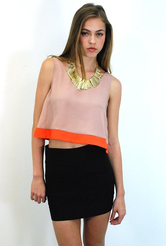 In sunset shades and a cropped fit, this stylish top can be dressed up or down with high-waisted bottoms.  West Coast Wardrobe Desert Color Block Top ($26)