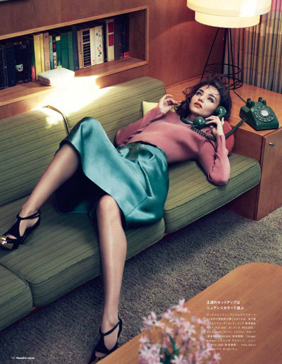 Miranda Kerr lounged on a couch in Numéro Tokyo magazine.