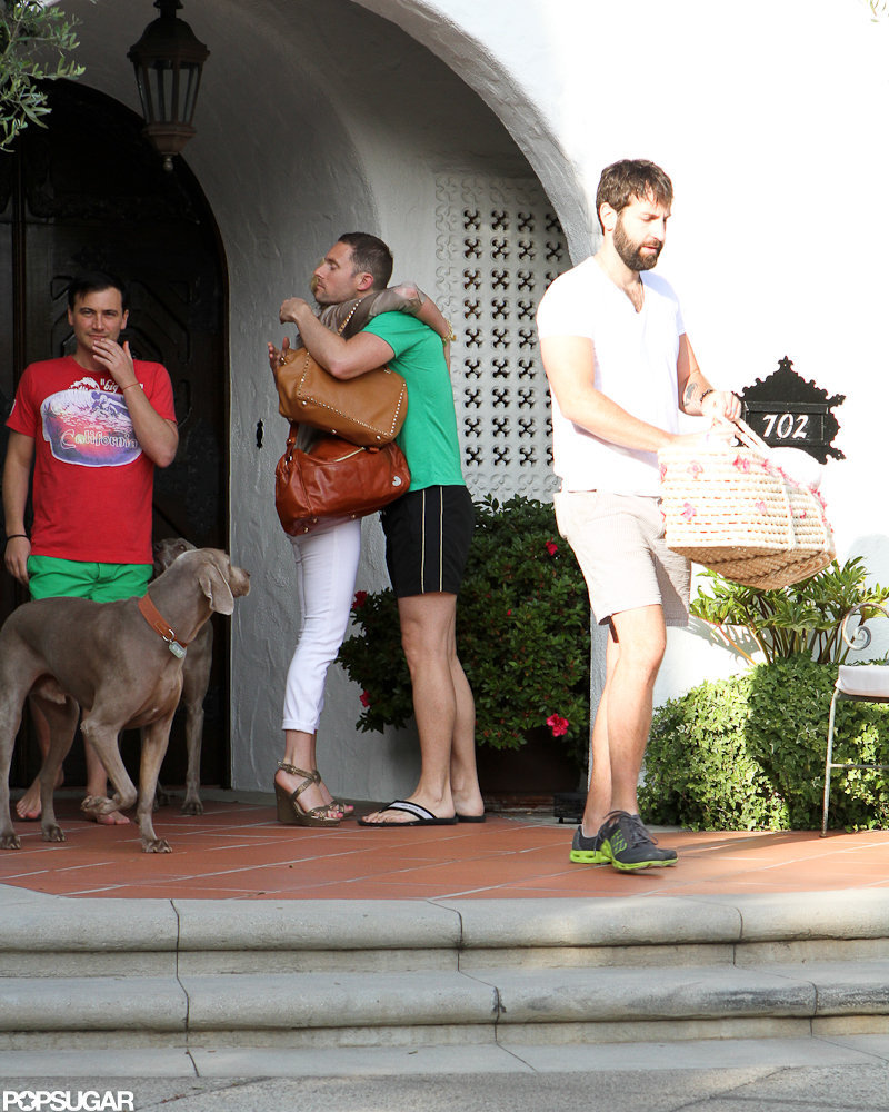 Josh Kelley and Katherine Heigl walked out of a friend's house in LA with their daughter in a bassinet.