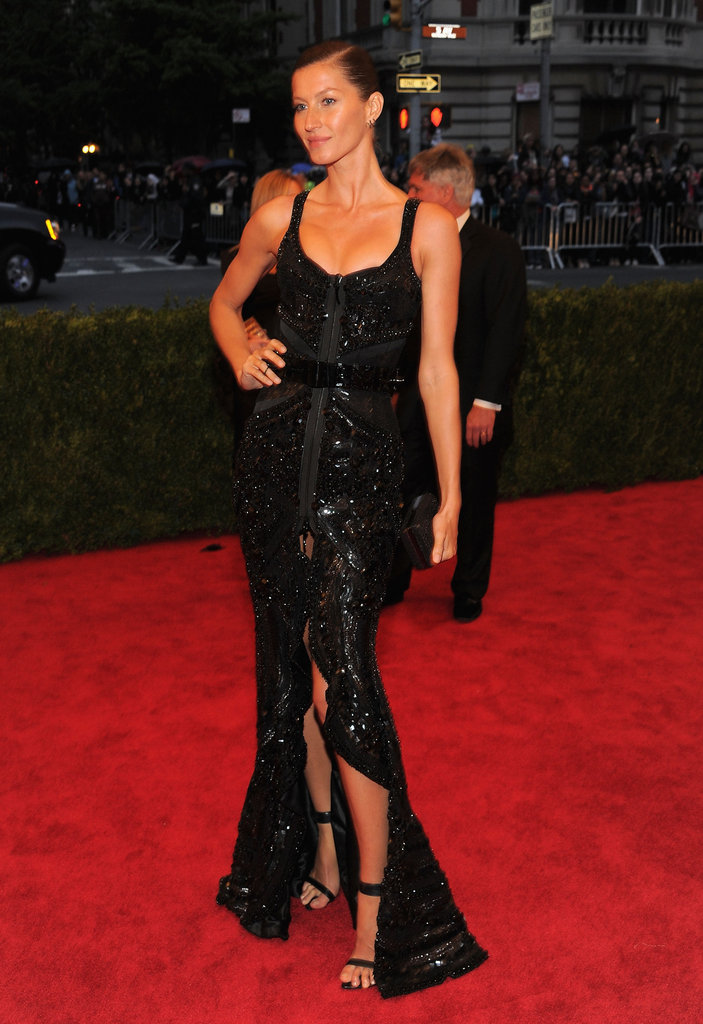 Gisele Bundchen wore a Givenchy dress with a front slit on the red carpet at the Met Gala.