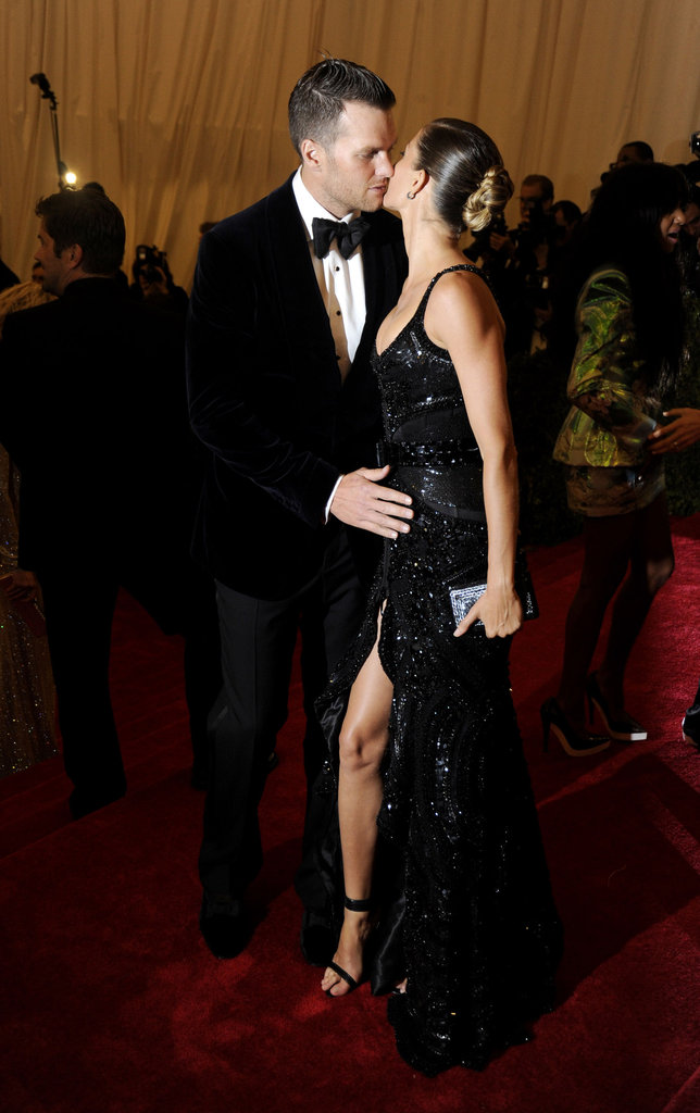 Tom Brady planted a kiss on Gisele Bundchen at the Met Gala in NYC.