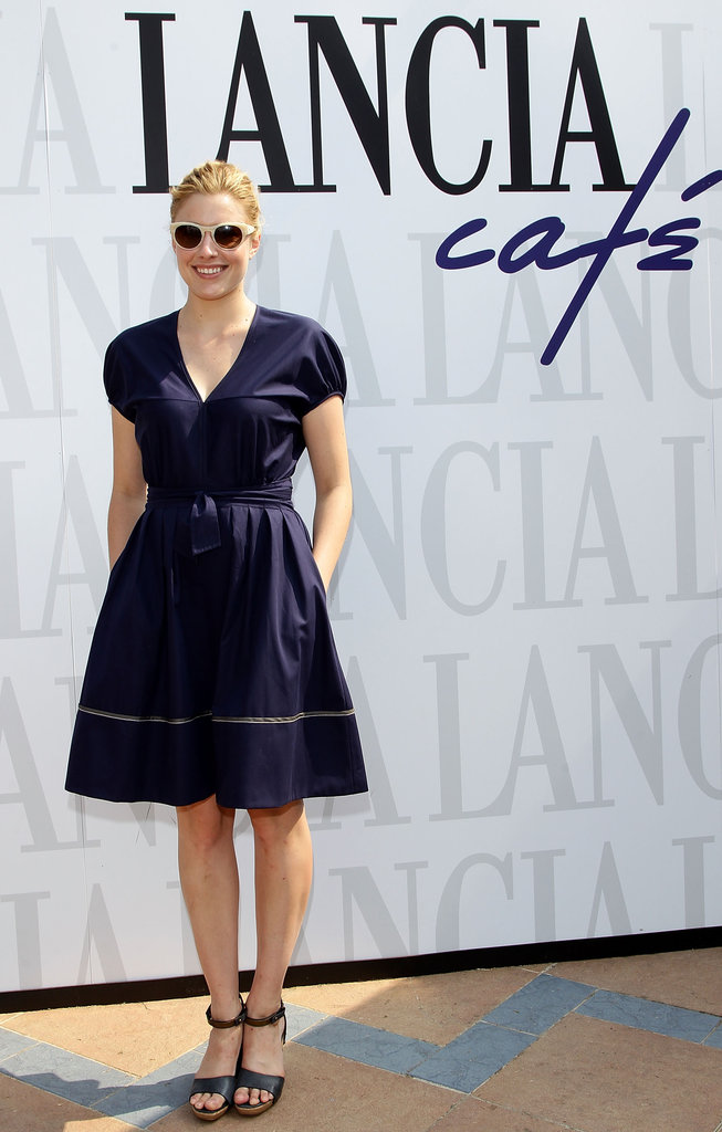 In Venice in September 2011, Greta showed off her sunny side in a ladylike navy dress and nude round sunglasses.  6855825