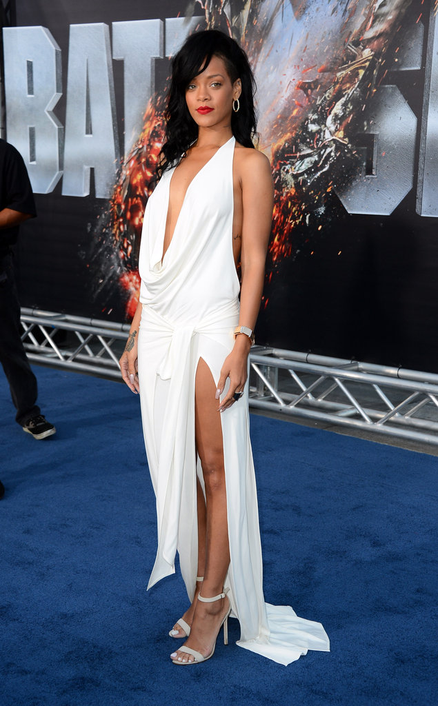 Rihanna showed off her legs in a white dress with a high slit at the premiere of Battleship in LA.