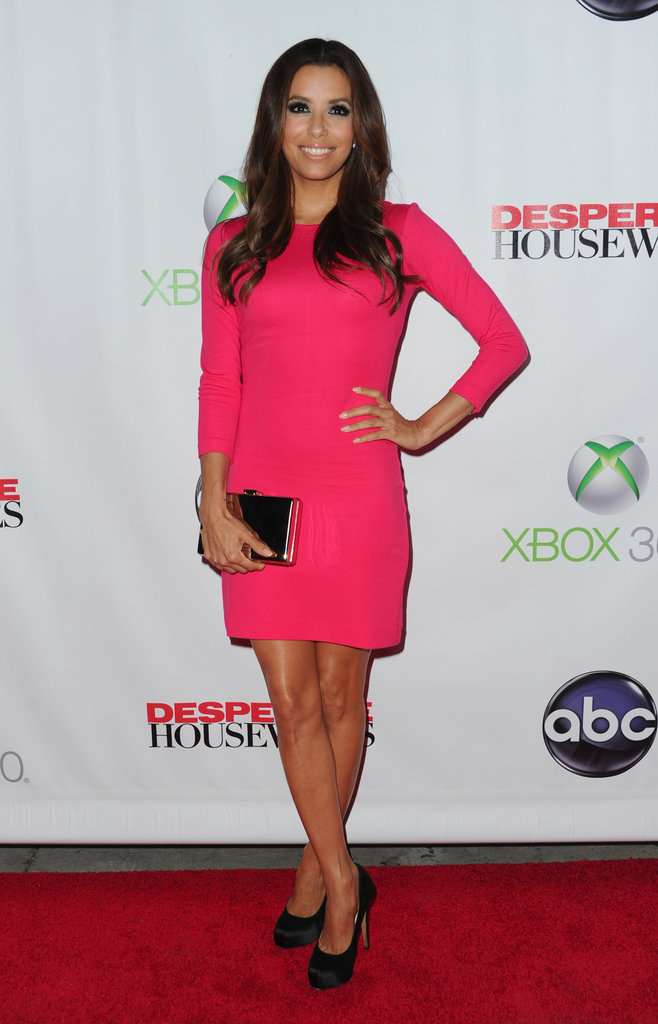 Eva Longoria paired her hot pink Ann Taylor shift dress with black Brian Atwood pumps and a mirrored box clutch.
