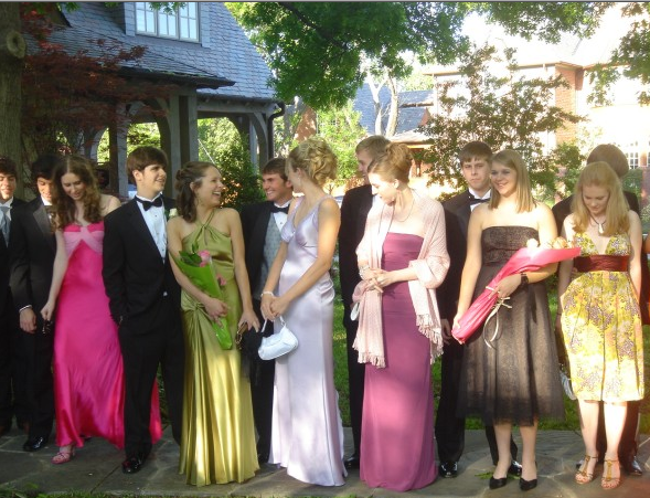 """I wore a purple Nicole Miller dress to prom — little did I know that a dozen other girls would show up wearing the same style in different colors! I was horrified at the time.""  — Anna Roberts"