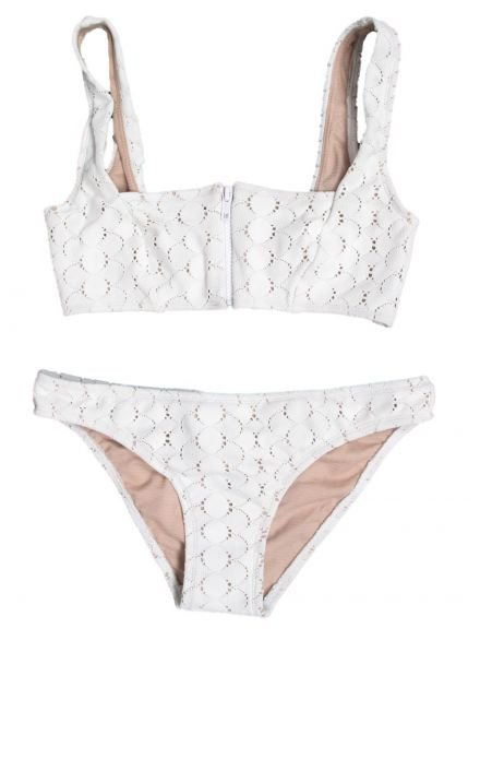 Play the sexy-sweet pinup this Summer in a cute eyelet bikini.  Lover Square Neck White Lace Bikini ($320)