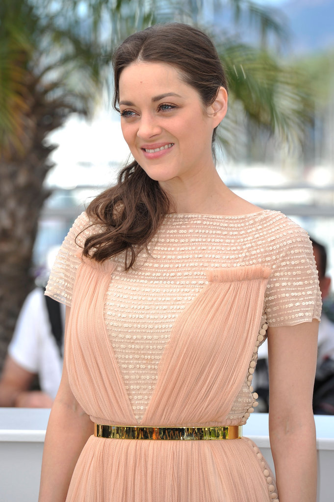 A closer glimpse of Marion Cotillard's bodice reveals a metallic gold belt at the waist and lots of texture.