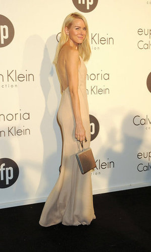 Naomi rocked a low-backed Calvin Klein nude slip dress — superchic.