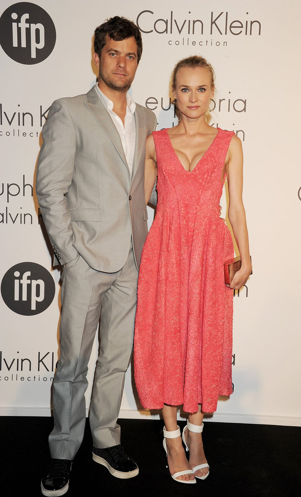 What a gorgeous couple! Diane Kruger arrived at the Calvin Klein Women in Film party with boyfriend Joshua Jackson and looked Spring-perfect in a tea-length coral Calvin Klein creation and white Givenchy sandals.