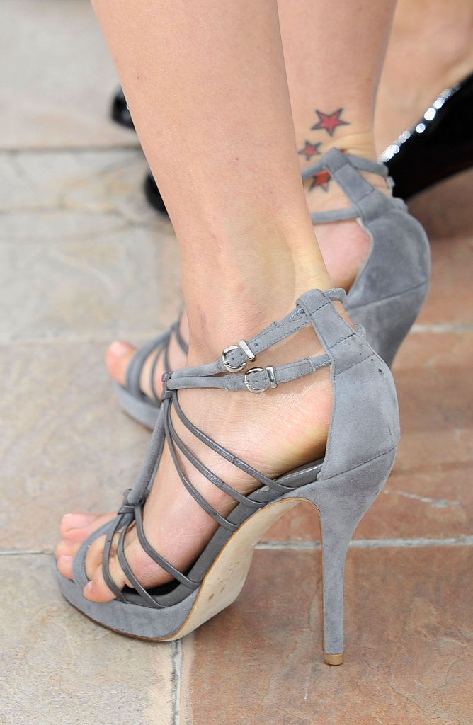 A close-up snap of Petra's grey strappy sandals.