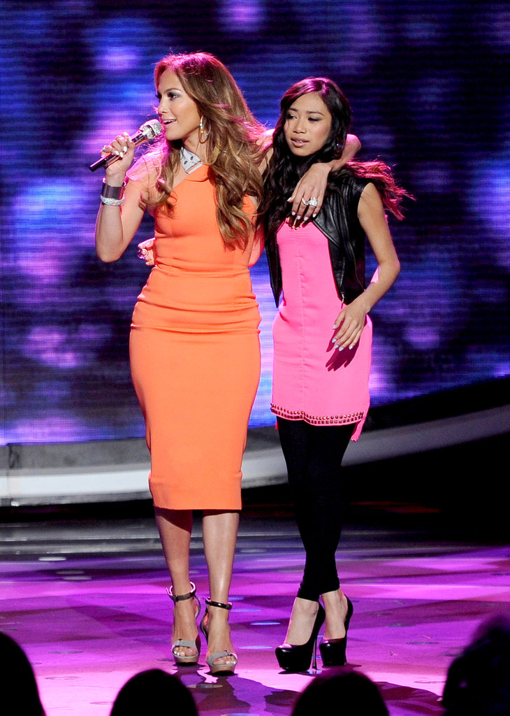 Jennifer was clearly attracted to bright hues on the show. While getting close with contestant Jessica Sanchez, she wore a tangerine Victoria Beckham dress ($2,750) with Lanvin wood platforms ($1,150). It was the perfect American Idol look, classy and sassy.  6931733