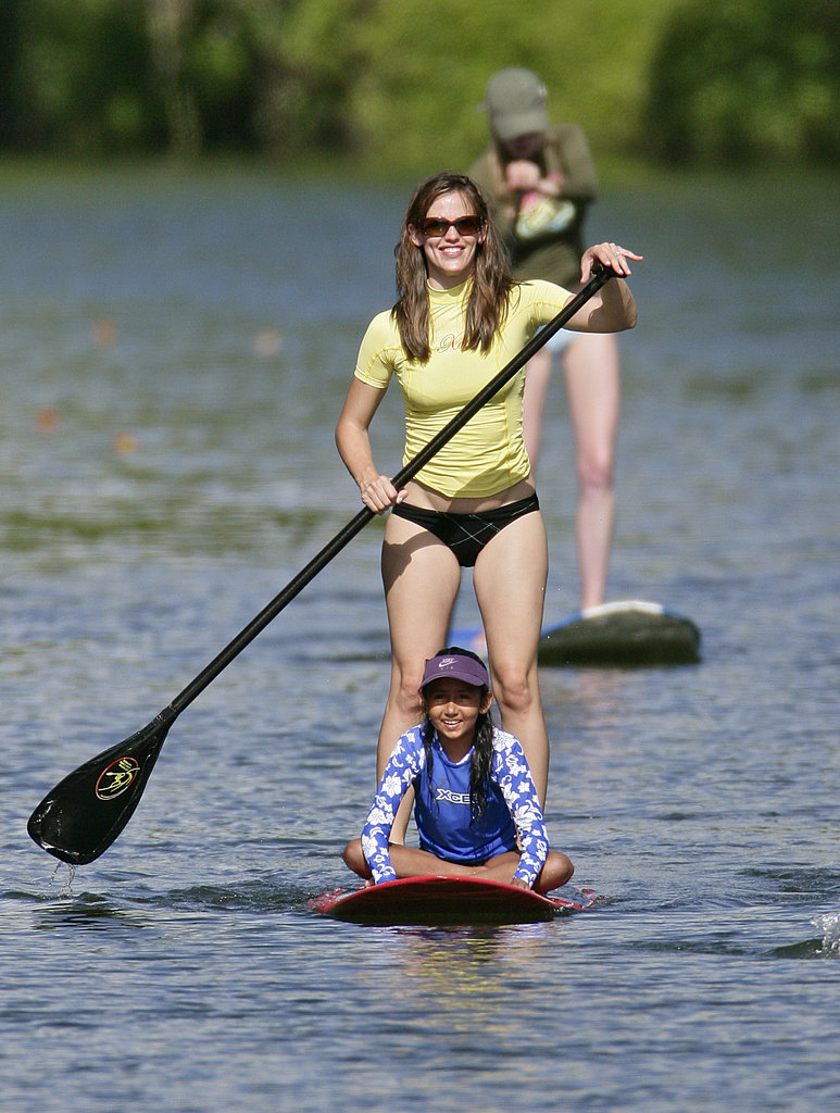 Jennifer Garner joined Matt Damon and his wife, Luciana, for a paddleboarding session while Luciana's daughter Alexa rode on the front of her board in Hawaii in June 2007.