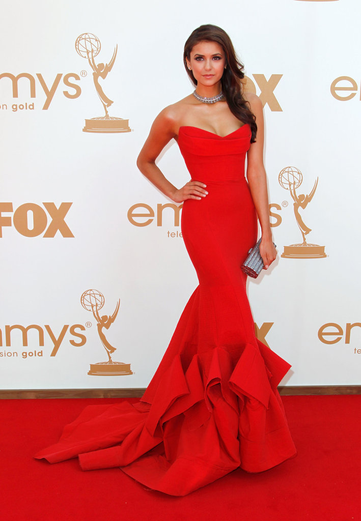 She turned more than a few heads in this utterly jaw-dropping Donna Karan siren-red strapless gown at the 2011 Emmys.
