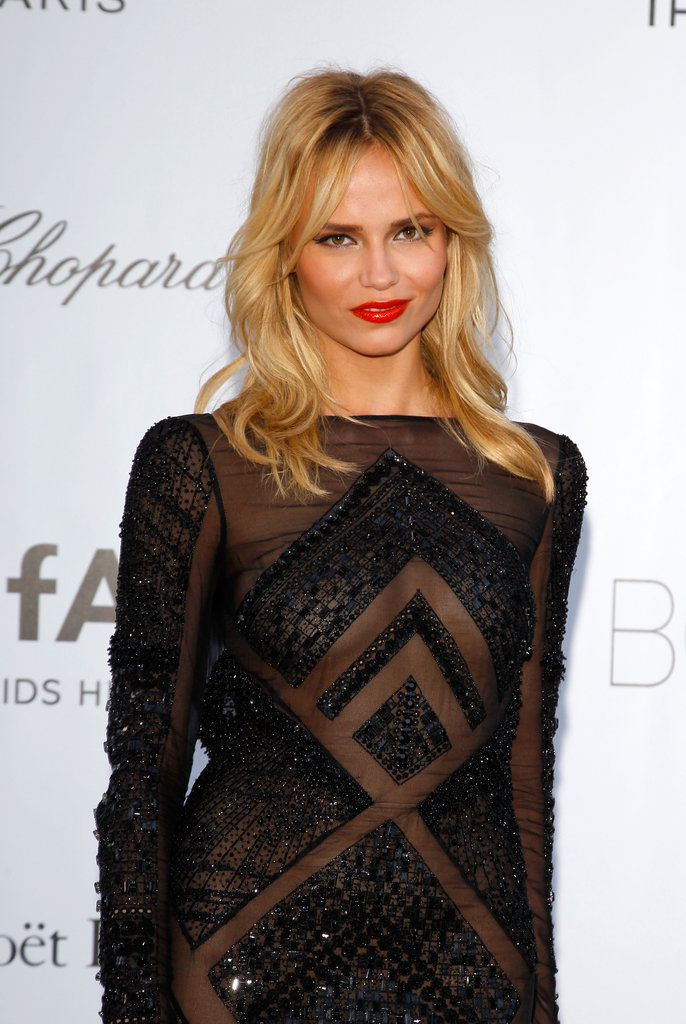 Natasha Poly opted for geometric-infused semisheer gown.