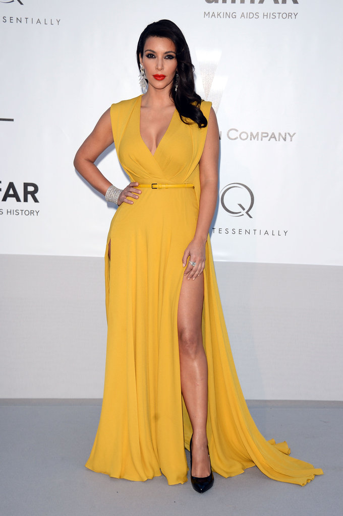 Kim Kardashian opted for a bold yellow statement — paired with black pumps — for her amfAR gala appearance.