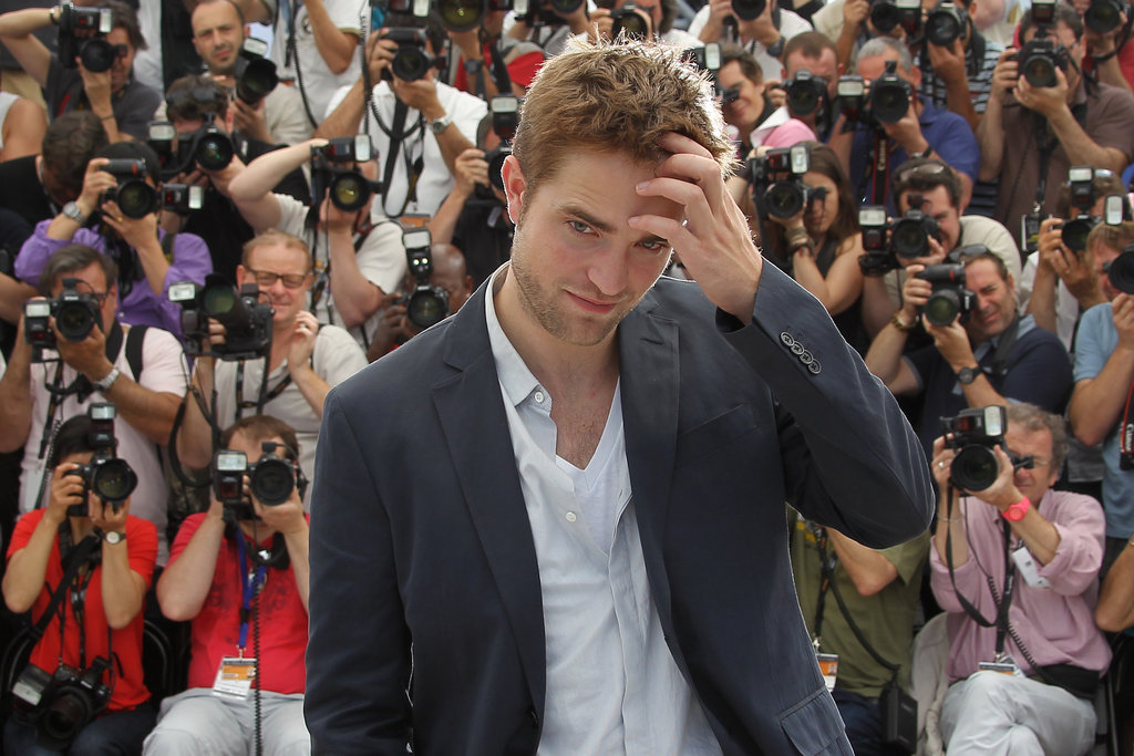 Robert Pattinson arrived at the Cosmopolis photocall in Cannes.
