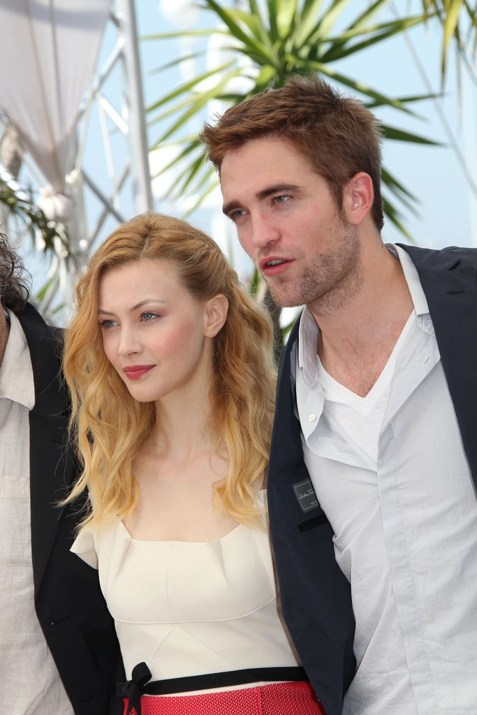 Robert Pattinson posed with Sarah Gadon at the Cosmopolis photocall in Cannes.