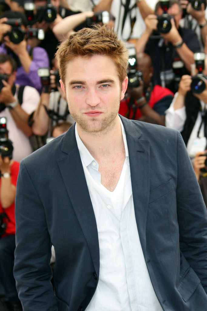 Robert Pattinson gave a sexy pose at the Cosmopolis photocall in Cannes.