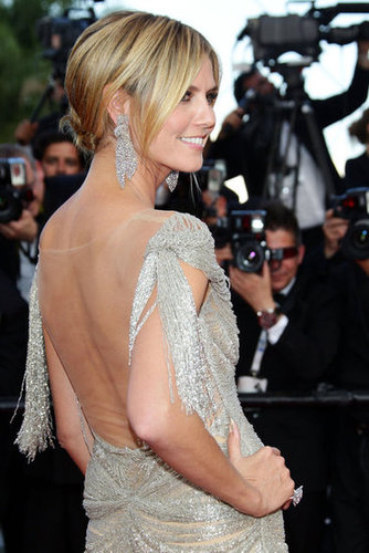 Heidi Klum sported some megawatt earrings to echo the glam of her gown.