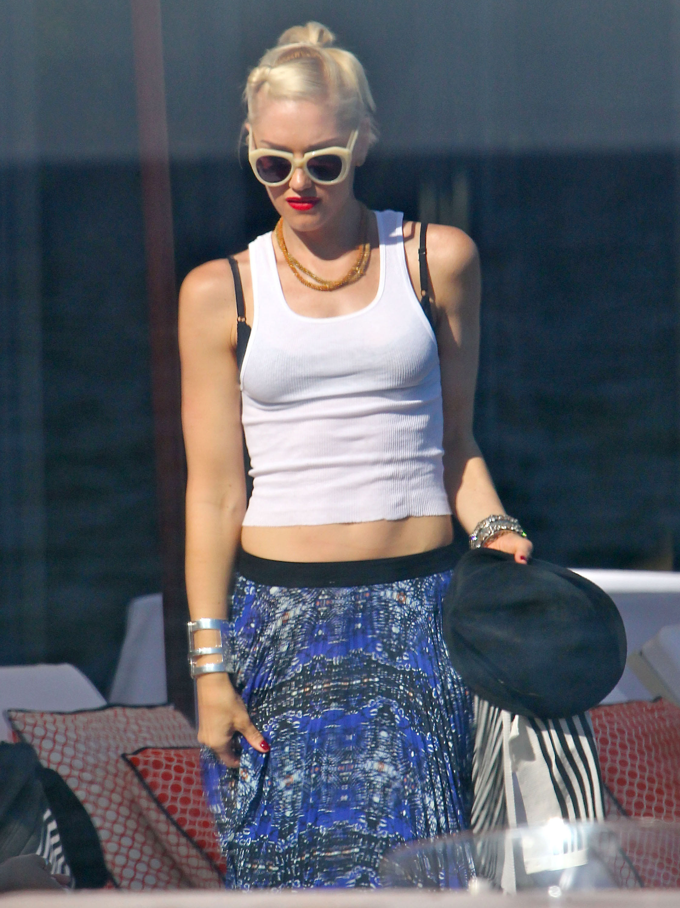 Gwen Stefani hung out by the pool at a Memorial Day party at Joel Silver's house in LA.