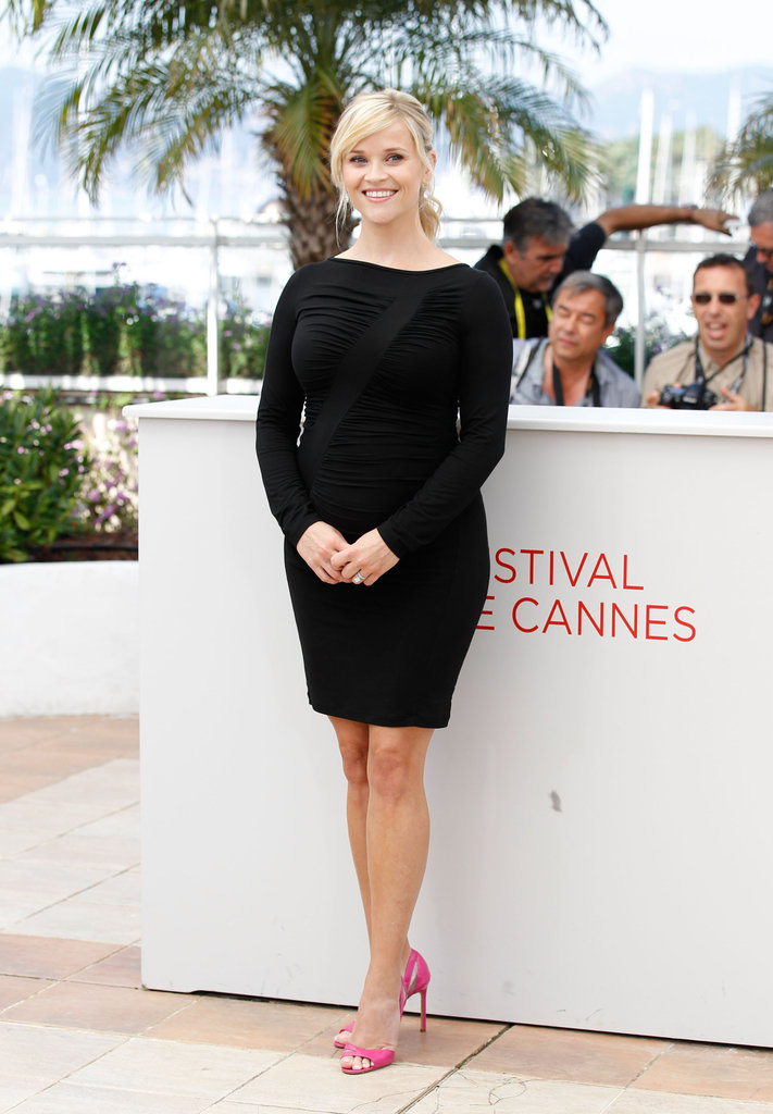 Reese Witherspoon accentuated her growing belly with a black ruched Versace LBD and hot pink Manolo Blahnik sandals.