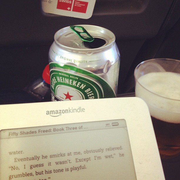"""Getting her Fifty Shades Freed fix, mollygoodson said, """"Keepin it classy on the flight to Madrid."""""""